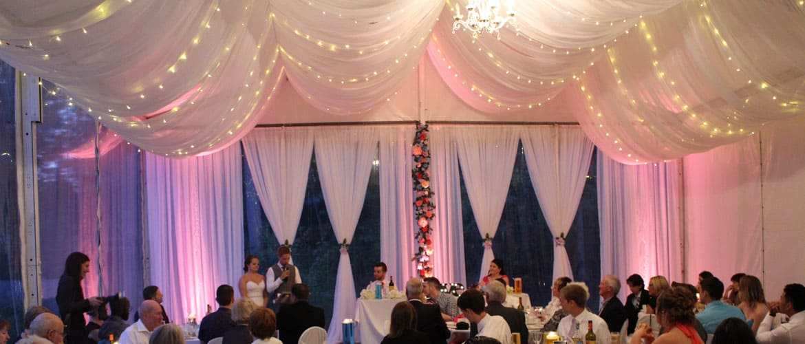 ceiling-draping-twinkle-lighting-flower-backdrop